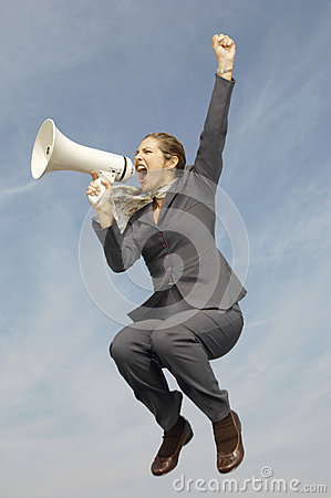 Businesswoman Shouting Into Megaphone Against Cloudy Sky