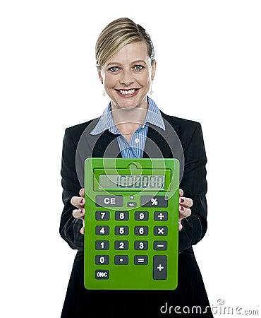 Businesswoman showing big green calculator