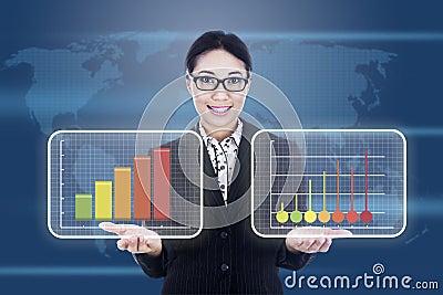 Businesswoman showing business diagram