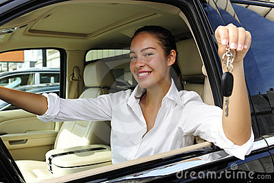 Businesswoman showing keys of new car