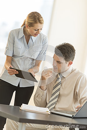 Businesswoman Showing Plan To Colleague On Digital Tablet In Off