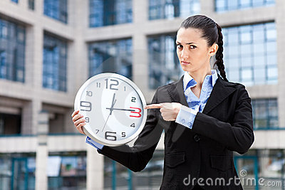 Businesswoman showing that running out of time