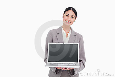 Businesswoman showing screen of her notebook