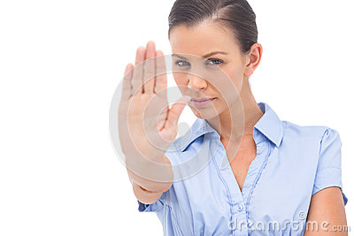 Businesswoman showing stop with hand