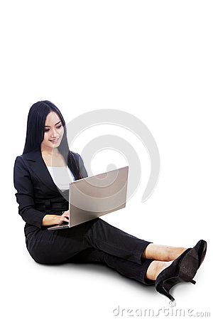 Businesswoman sit with laptop isolated