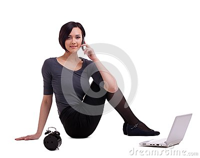 Businesswoman sit with laptop talk on cell