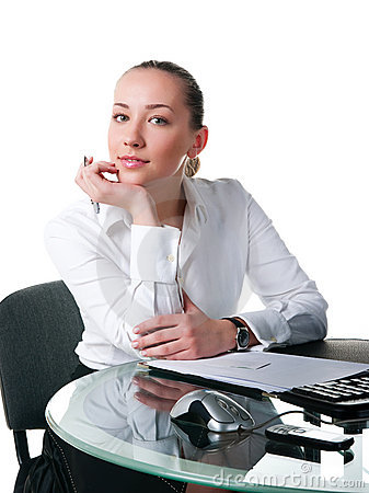 Businesswoman sits at the computer
