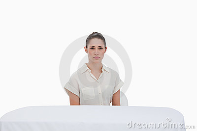 Businesswoman sitting behind a table