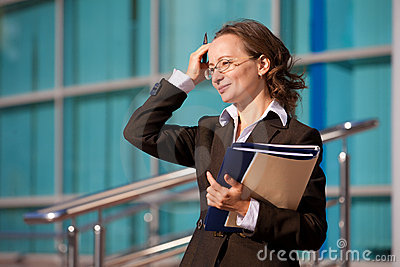Businesswoman sitting with documents and laptop