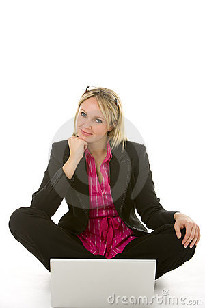 Businesswoman Sitting In Front Of Laptop Thinking