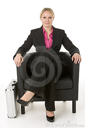 Businesswoman Sitting In Leather Chair