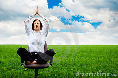 Businesswoman sitting in lotus