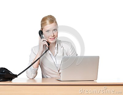 Businesswoman sitting with phone handset