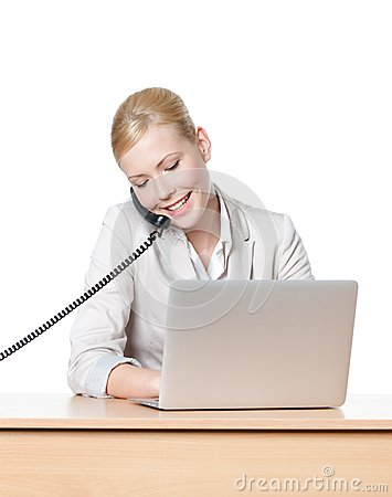Businesswoman sitting talking by phone