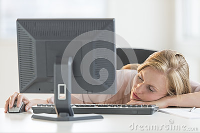 Businesswoman Sleeping At Computer Desk
