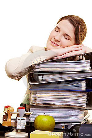 Businesswoman sleeping on files