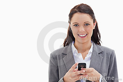 Businesswoman smiling and holding her mobile