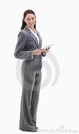 A businesswoman smiling with a touch pad