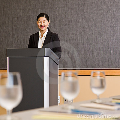 Free Businesswoman Standing Behind Podium Royalty Free Stock Photography - 6603317