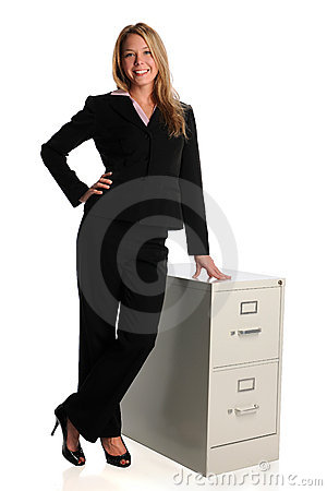 Businesswoman Standing By File cabinet