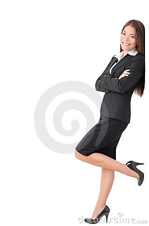 Businesswoman standing leaning on sign