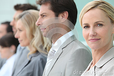 Businesswoman standing in a line