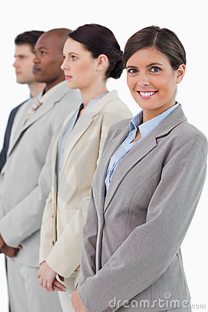 Businesswoman standing next to her associates