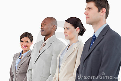 Businesswoman standing next to her colleagues