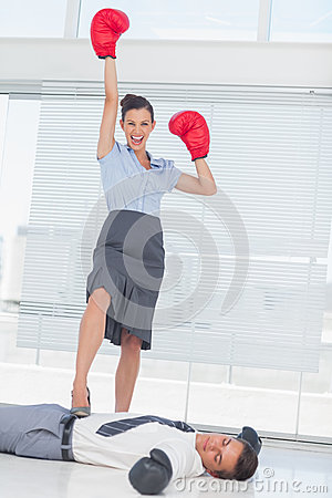 Free Businesswoman Standing On Defeated Businessman Wearing Boxing Gl Royalty Free Stock Images - 32517459