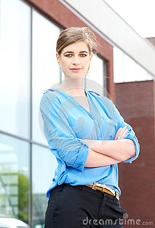 Businesswoman standing outdoors with arms crossed