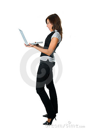 Businesswoman standing surprised with laptop
