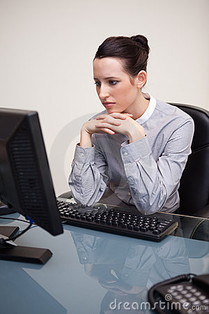Businesswoman staring at her computer screen
