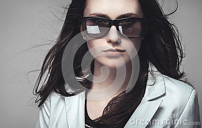 Businesswoman staring through sunglasses