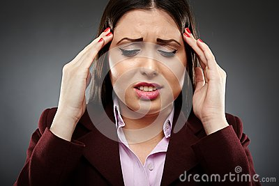 Businesswoman with a strong migraine