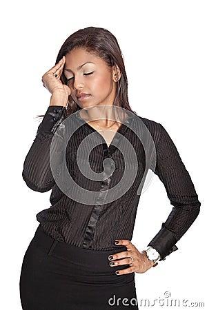 Businesswoman suffering from work related headache