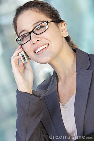 Businesswoman in Suit and Talking on Cell Phone