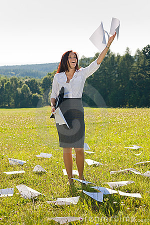 Businesswoman sunny meadow throw papers freedom