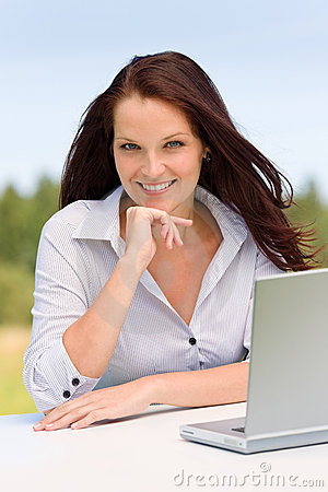 Businesswoman in sunny nature with laptop smile