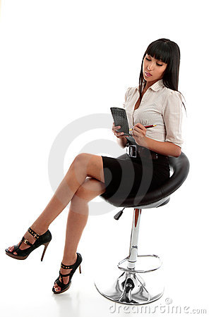 Businesswoman taking dictation or notes