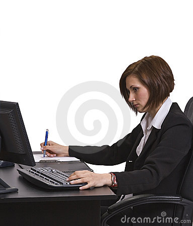 Businesswoman taking notes at her desk.