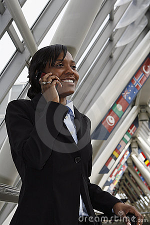 Free Businesswoman Talking On Her Cellphone Royalty Free Stock Image - 5184196
