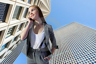 Businesswoman talking on phone on urban background