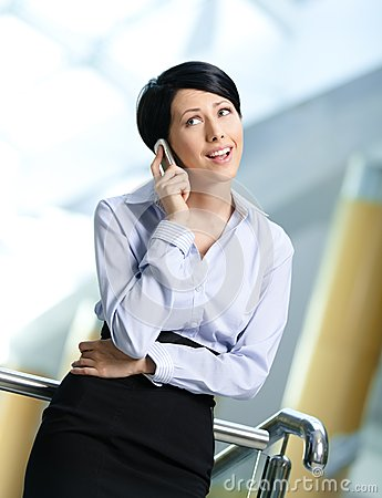 Businesswoman talks on cellular phone