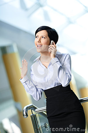 Businesswoman talks on telephone