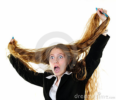 Businesswoman tearing her hair