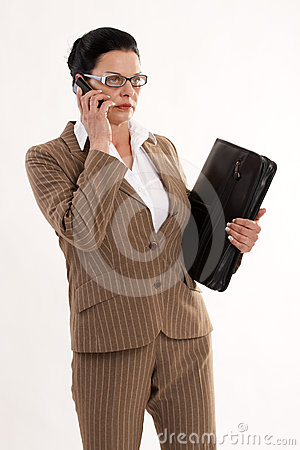 Businesswoman with telephone and timer