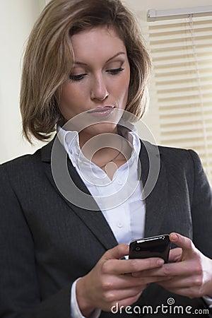 Businesswoman text messaging