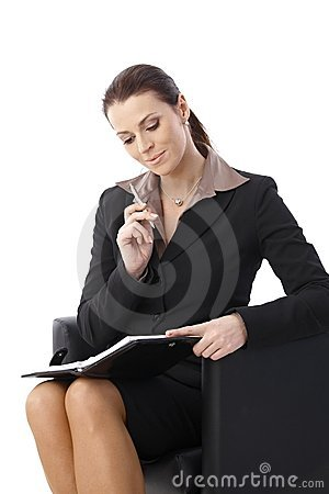 Businesswoman thinking looking at organizer
