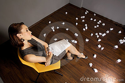 Businesswoman throwing crumpled paper on floor