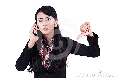 Businesswoman with thumb down